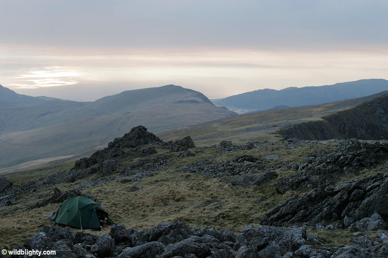 Wild Camping on Cadair Idris close to its summit with views of the Irish Sea