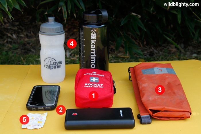 Wild Camping Kit List Essentials - Dry Bag, Phone, Power Bank, First Aid Kit, Water Bottles & Water Purification Tablets
