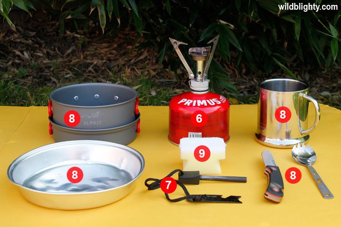 Wild Camping Kit List Essentials - Pocket Rocket Stove & Fuel, Fire Steel, Pan with Lid, Mug, Spork, Folding Knife, Plate & Cleaning Sponge