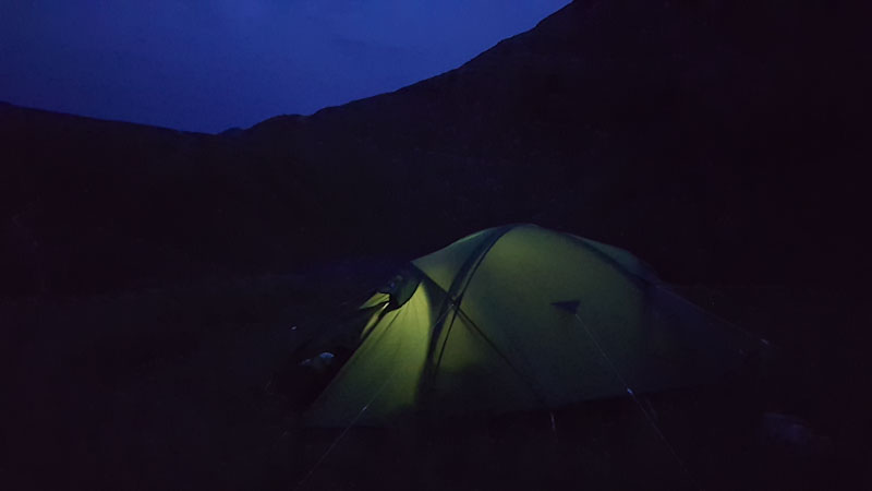 tent and mountains at dusk