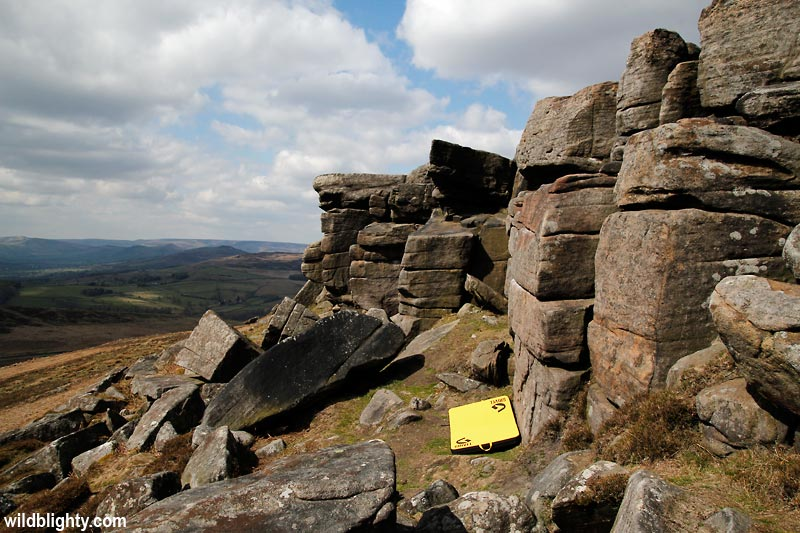 Bouldering mat amongst the Stanage boulders